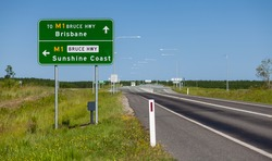 A typical road sign in Queensland Australia, giving directions to the on ramps to the Bruce Highway for drivers to head South to Brisbane or North to the Sunshine Coast.