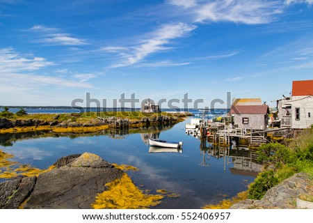 A typical scenic, small fishing village and harbor in the Maritimes,a tourist destination  on Nova Scotia, Canada, lots of blue water and skies