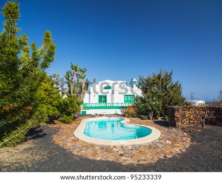 A typical summer villa with a swimming pool. Lanzarote, Canary Islands, Spain