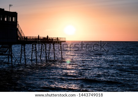 A typical Uk pier at sunset #1443749018