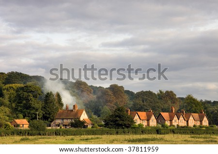 A typical view of rural housing surrounded by countryside in rural Oxfordshire, England, in early autumn.
