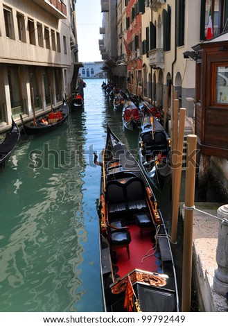 A typical water channel named Rio wih gondole - Venezia - Italy
