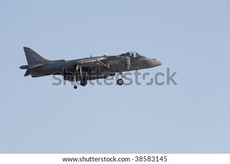 "A U.S. Marine AV-8B Harrier II ""Jump Jet"" hoving over the ground"