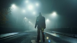A UFO concept of glowing orbs, floating above a misty winters road at night. With a silhouetted figure , back to camera, looking at the lights.