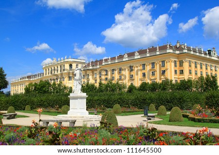 A UNESCO World Cultural Heritage: Statue and beautiful garden at Schloss Schoenbrunn Palace with blue sky in Summer. One of beautiful tourist attractions in Vienna, Austria