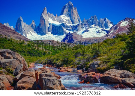 A unique and beautiful scenery: a blue river in El Chaltén, Patagonia, and Mount Fitz Roy in the background. Located at the Southern Patagonic Andes between Chile and Argentina.