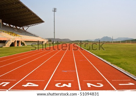 A university running track, around an football field.