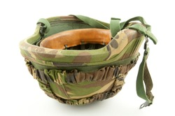 A up side down helmet of a soldier with Dutch woodland camouflage