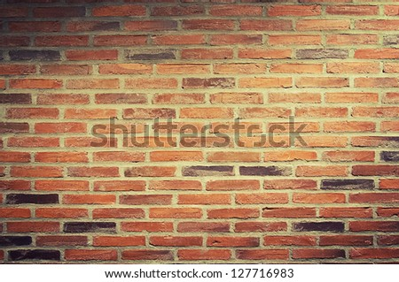 a urban background, red brick wall