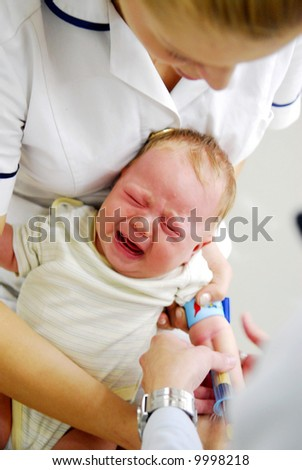 A vaccinate of a small baby - stock photo