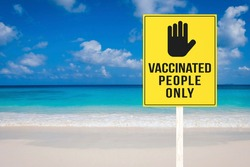 A vaccination required sign at a beach or seaside resort. Vaccinated people only permitted to enter premises. Travel regulation.