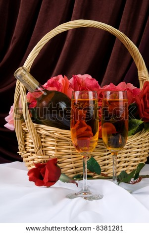 A Valentine's day basket filled with roses and wine