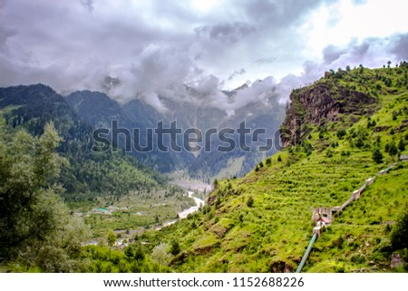 A valley is a low area between hills or mountains often with a river running through it. In geology, a valley or dale is a depression that is longer than it is wide. The terms U-shaped. #1152688226