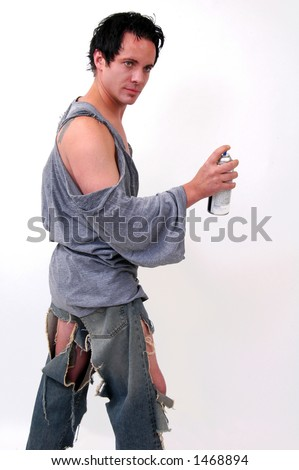 vandal in torn clothing about to spray paint a wall stock photo. Black Bedroom Furniture Sets. Home Design Ideas