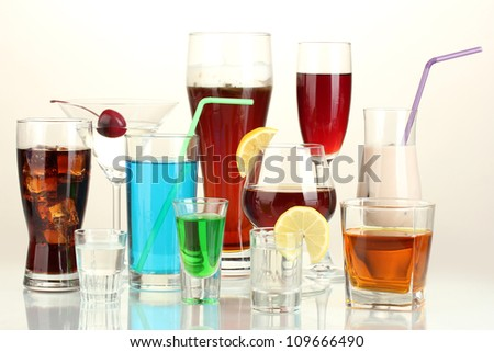 a variety of alcoholic drinks isolated on white