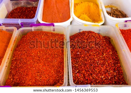 A variety of bright spices on the market. Background from spices.