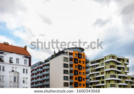 A variety of colored facades of buildings.