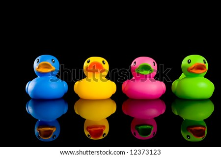 A variety of colorful ducks on a black background, individualtiy, uniqueness or variety concept.