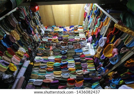 a variety of colorful fabrics and various types of fabric motifs in fabric sellers