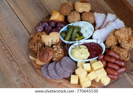 a variety of delicacies assortment of cold and hot appetizers for beer.  High Beer