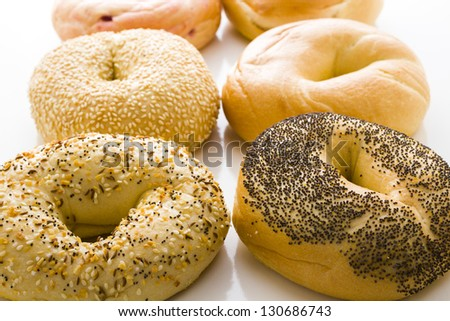 A variety of delicious, freshly baked bagels. - stock photo