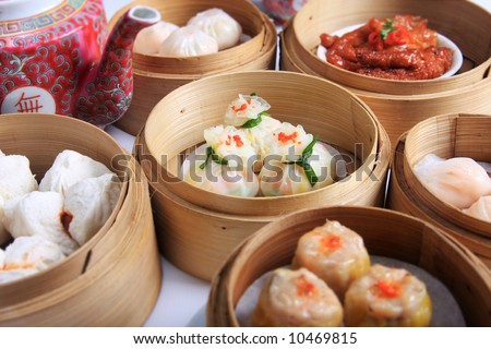 A variety of dim sum in bamboo steam containers - stock photo