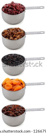 A variety of dried fruit - cranberries, sultanas, currants, apricots and raisins - in cup measures, isolated on a white background