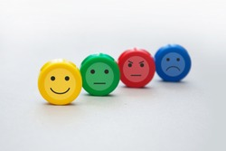 A variety of emotions: joy, serenity, anger, sadness on the colored cubes