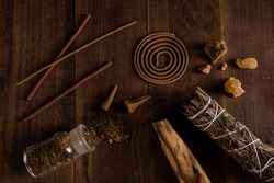 A variety of incense on wood background.