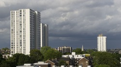 A variety of low, medium and high rise social housing types in north London, England.High rise apartments tower over local authority housing and flats amidst a splash of green trees.
