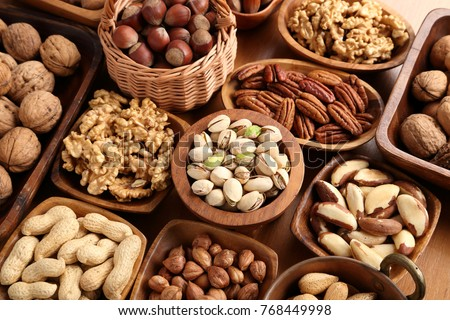 A variety of nuts in wooden bowls.