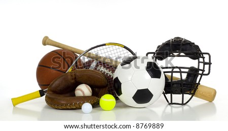 A variety of sports gear on a white background including tennis racket and ball, a soocer or football, an american football, a baseball bat, glove and catcher's mask and a basketball with copy space