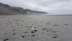 a variety of stones on grey sand