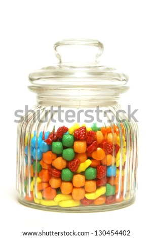 A variety of tasty candies in cliche candy jar.