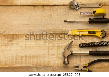 A variety of tools on wood. Advertising space #258274025