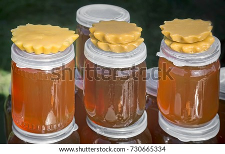 A variety of varieties of honey in jars offered for sale at the  #730665334