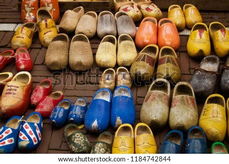 A Variety Second Hand Vintage Clogs In Various Colours On Display For Sale In Market In Amsterdam, Holland - Image