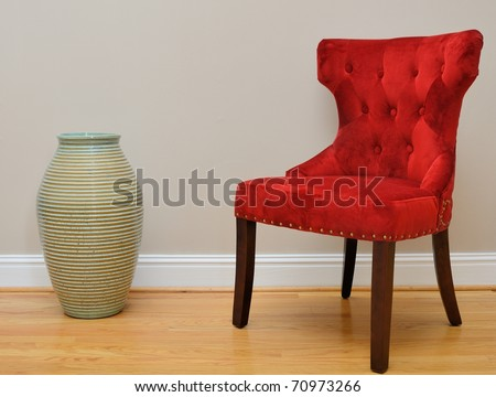 a vase and chair in a home