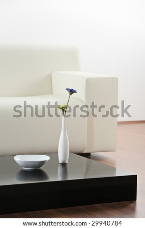A vase and flower at table in modern  living-room - stock photo