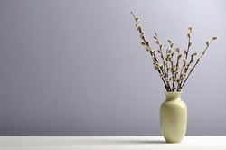 a vase with a willow on a table. Easter, spring back