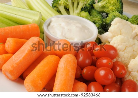 A vegetable platter with blue cheese dressing