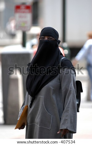 A veiled woman in the city