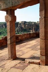 A verandah with a stone pillar and slabs in a temple at Badami, Karnataka, India, Asia