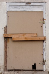 A vertical closeup of an old unused door