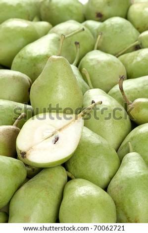 a vertical frame full of green pears