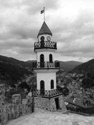 A vertical greyscale shot of the Victory Tower in Goynuk, Turkey captured on a cloudy day