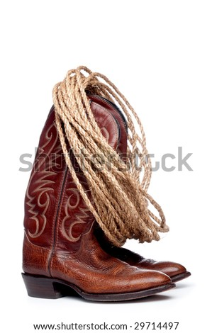 a vertical image of a pair of brown cowboy boots and a coil of rope on a white background