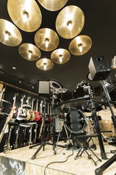 A vertical low angle shot of a drum set in a musical instrument store