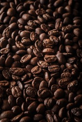 A vertical shot of a lot of coffee beans - great for a cool wallpaper or background