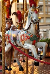 A vertical shot of a merry-go-round horse